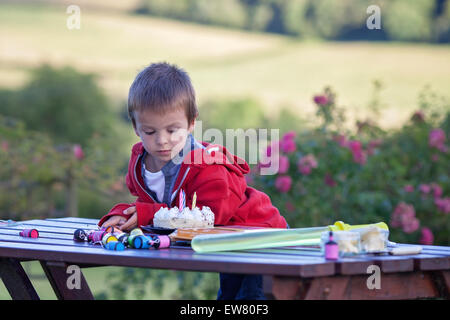 Cute boy, celebrating his birthday outdoor, summertime - Stock Photo