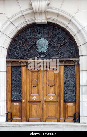 Wooden door and archway entrance to a church in London - Stock Photo
