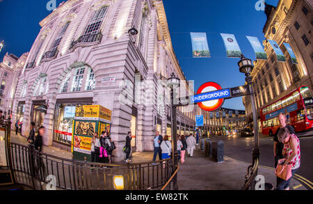 Piccadilly Circus Underground Station Entrance  at Night London UK - Stock Photo