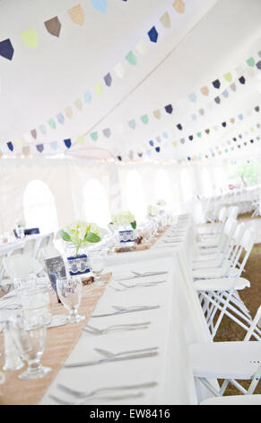Tables and tent Country style wedding reception n backwoods of Florida - Stock Photo