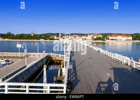 Polish Sopot summer resort at the Baltic Sea viewed from the wooden pier in the morning - Stock Photo