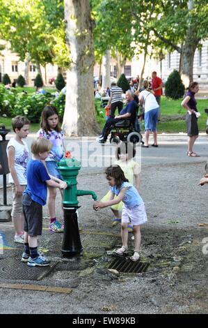 Children playing at Zrinjevac or Josip Juraj Strossmayer park, Zagreb, Croatia - Stock Photo