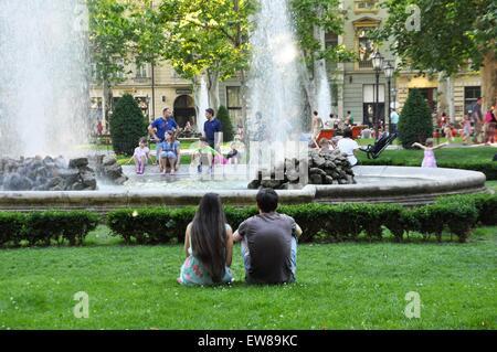 Young couple at Zrinjevac or Josip Juraj Strossmayer park, Zagreb, Croatia - Stock Photo