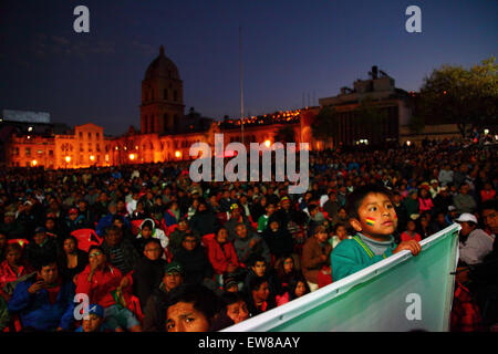La Paz, Bolivia, 19th June 2015. A young Bolivian football fan watches the Bolivian team play Chile in the final Copa America Group A game on a giant screen in Plaza San Francisco. Bolivia lost the match 5-0 but still qualified for the quarter finals in 2nd place in the group. Credit:  James Brunker / Alamy Live News
