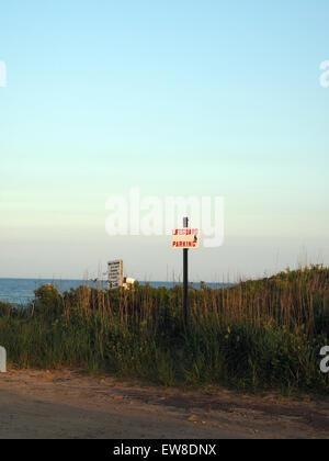 empty parking lot with  lifeguard parking sign Ditch Plains Beach Montauk New York - Stock Photo