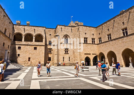 Tourists visiting The Palace of the Grand Master of the Knights of Rhodes a medieval castle in the city of Rhodes. - Stock Photo