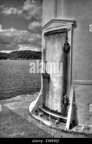 Rusty door of a lighthouse, processed as an HDR image. - Stock Photo