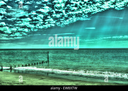 Seascape and clouds, processed as an HDR image. - Stock Photo