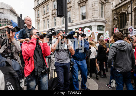 London, UK. 20th June, 2015. Masses of people marching through the streets of London on the 20th of June 2014 protesting - Stock Photo