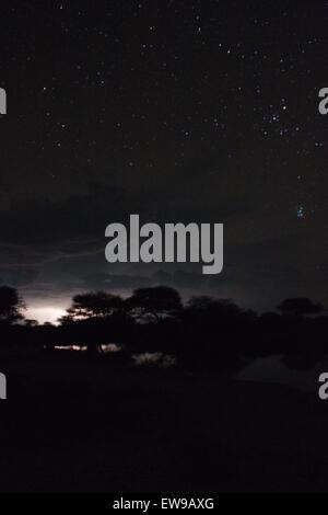 Long exposure stars and lightning Etosha Namibia - Stock Photo