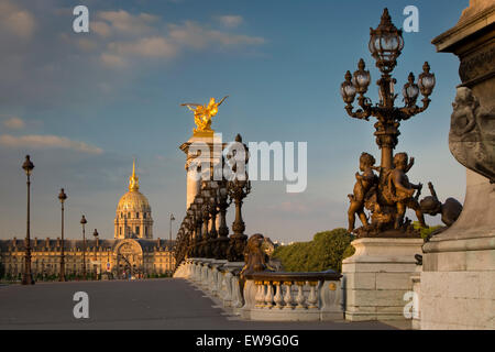 Dawn along the ornate Pont Alexandre III with Hotel les Invalides beyond, Paris, France - Stock Photo