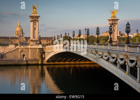 Dawn over River Seine, Pont Alexandre III and Hotel les Invalides, Paris, France - Stock Photo