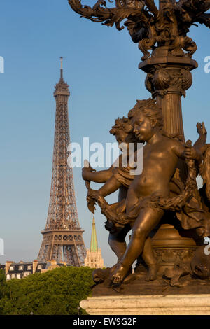 Cherub statue on lamppost along Pont Alexndre III with Eiffel Tower beyond, Paris, France - Stock Photo