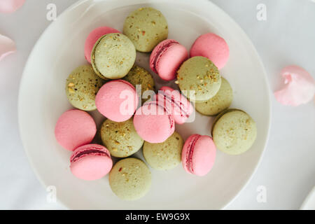 Fresh macarons on white plate - Stock Photo