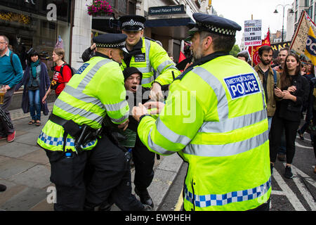 London, UK. 20th June, 2015. Police arrest a man as thousands march against austerity. London, UK.   20th March - Stock Photo