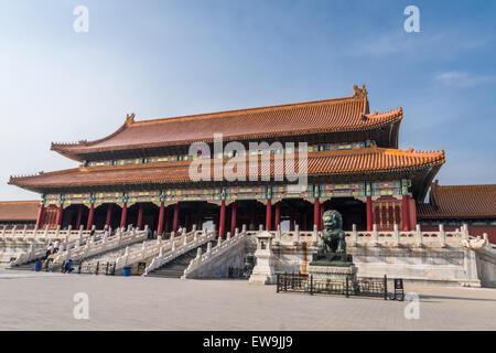 Lion statue guarding Forbidden City Hall - Stock Photo
