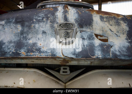 PAAREN IM GLIEN, GERMANY - MAY 23, 2015: Fragment of rusted body of full-size pickup truck Ford F100. The oldtimer - Stock Photo