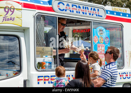 Family Buying Ice Creams From A Traditional Ice Cream Van, Maresfield Fete, Maresfield, Sussex, UK - Stock Photo