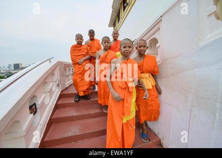 Young Buddhist monks at Wat Saket (The Golden Mount) in Bangkok, Thailand - Stock Photo