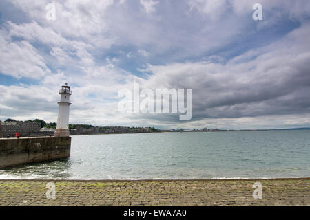 Lighthouse in Newhaven harbour on a sunny day - Edinburgh, Scotland - Stock Photo