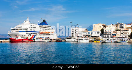 AGIOS NIKOLAOS, GREECE. Cruise ship and boats in the port of old town. - Stock Photo