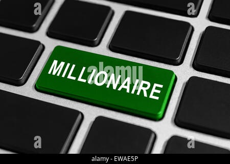 millionaire green button on keyboard, business concept - Stock Photo