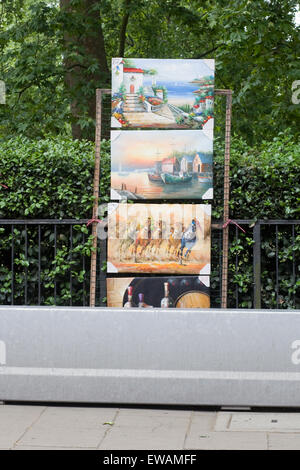 Paintings and Prints on sale in London's Hyde Park - Stock Photo