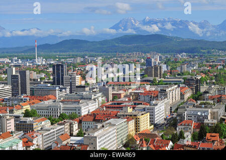 Aerial view of Slovenian capital Ljubljana with Alp mountains in the background - Stock Photo