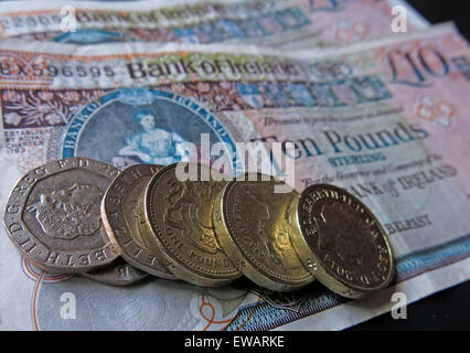 Northern Irish £5, £10 notes and pound coins, legal tender from the Bank Of Ireland  Belfast - Stock Photo