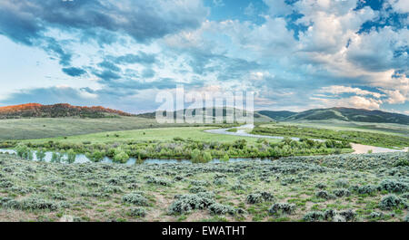 dusk over North Platte River in Colorado North park above Northgate Canyon, early summer scenery - panorama - Stock Photo