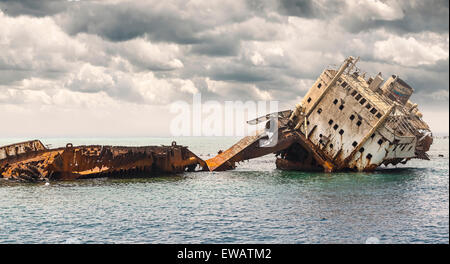 The sunken shipwreck on the reef, Red Sea in Egypt. - Stock Photo