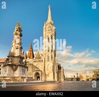 Matthias church, Trinity Monument and Fishermans Bastion in Buda Castle district, Budapest, Hungary - Stock Photo