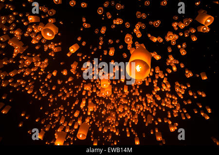 Floating lantern in Yee Peng festival (Loy Krathong), Buddhist floating lanterns to the Buddha in Sansai district - Stock Photo
