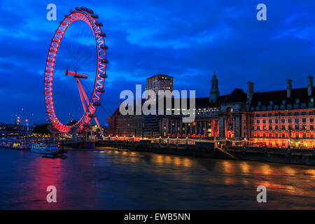 Landscape image of the London Eye and County Hall on the South Bank of the River Thames at dusk London England UK - Stock Photo