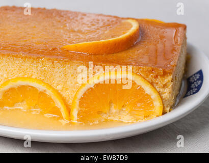 Orange custard in a studio shot. A delicious dessert. - Stock Photo