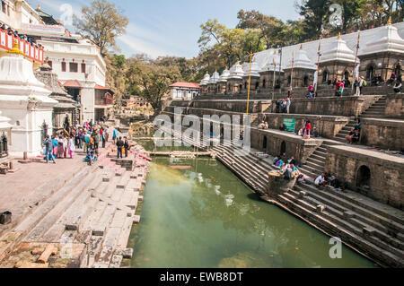 A Hindu funeral at Pashupatinath Temple, a Hindu temple located on the banks of the Bagmati River. Kathmandu, Nepal - Stock Photo