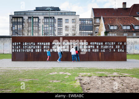 Portraits of victims, Memorial of the Berlin Wall, Berlin, Germany - Stock Photo
