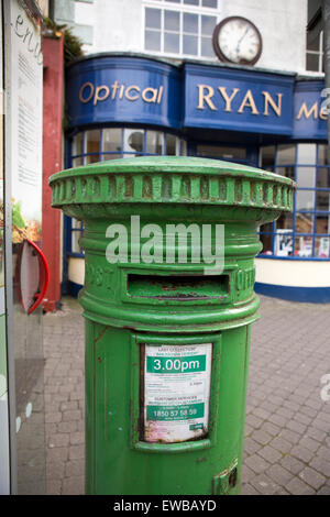 Ireland, Co Wexford, Wexford Town, Common Quay Street, green painted Irish Post pillar box - Stock Photo