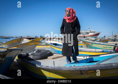 The Gaza Strips only Fisherwoman 21 year old Madeline Kollab stands on her damaged fishing boat in Gaza Port. - Stock Photo