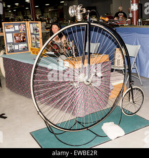 Original 1878 Penny Farthing Bicycle on display at the Antique Power Show in Lindsay, Ontario - Stock Photo