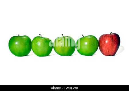 Odd One Out.  Row of green apples with red apple on the end.  Concept of being different or different lifestyle - Stock Photo