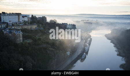 Misty morning in winter, view from the Clifton Suspension Bridge of the River Avon - Stock Photo