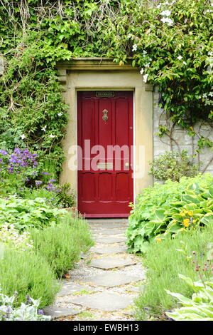 A traditional English cottage garden frames the path to a country ...