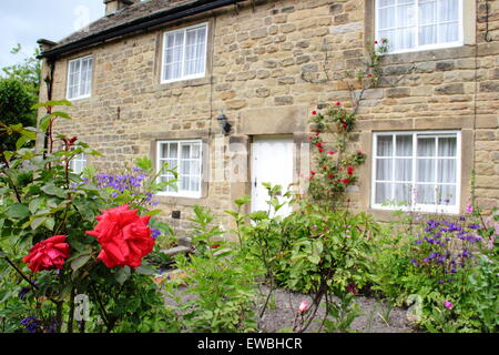 A 'plague cottage' on the main street at Eyam village in the Peak District NP, Derbyshire UK - Stock Photo