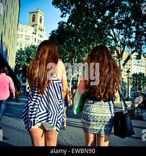 Two young women walking. Barcelona, Catalonia, Spain. - Stock Photo