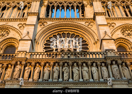 Setting sunlight on the front facade of Cathedral Notre Dame, Paris, France - Stock Photo