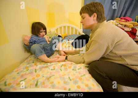 A mother disciplines a child. - Stock Photo