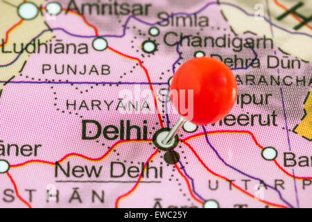 Close-up of a red pushpin on a map of Delhi, India - Stock Photo