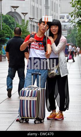 selfie stick photo attractive beautiful young  Visitors at Nanjing Road. Main shopping street of Shanghai. China - Stock Photo
