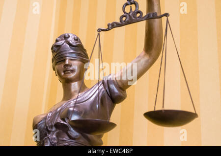 Bronze statue of 'Lady Justice', blindfolded and holding a pair of scales - Stock Photo